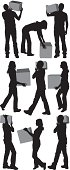 People carrying cardboard boxes
