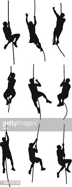 people climbing a rope - rock climbing stock illustrations, clip art, cartoons, & icons