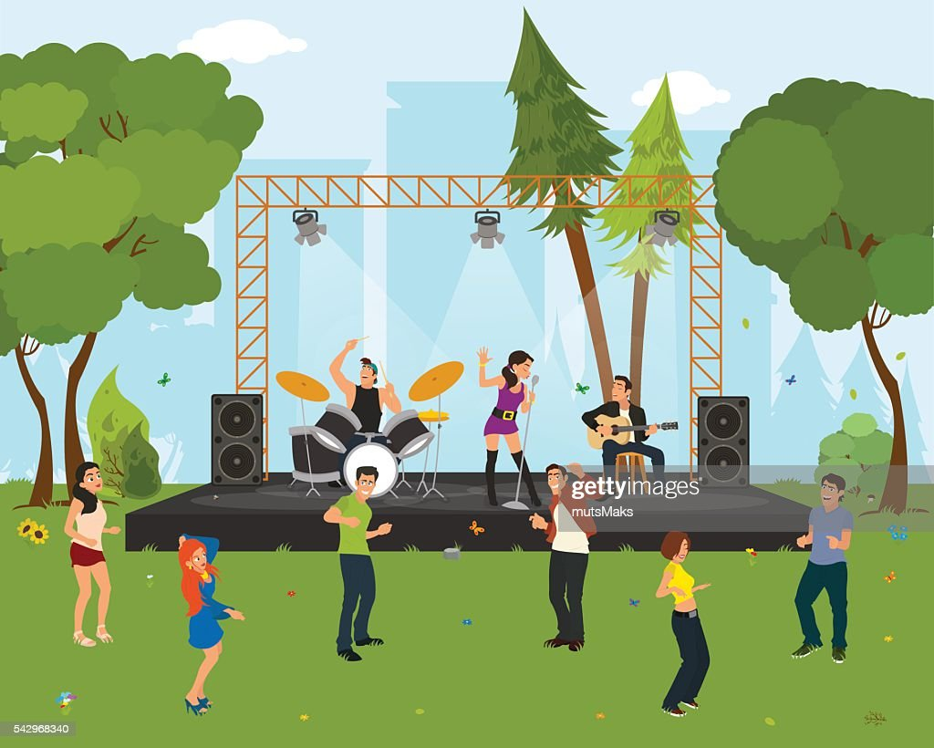 People dancing in the city park at the concert.