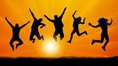 People friends jumping at sunset, silhouette vector