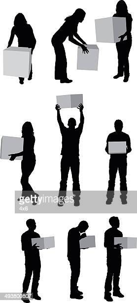 People holding box