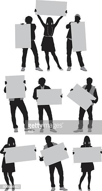 people in action with placard - holding stock illustrations, clip art, cartoons, & icons