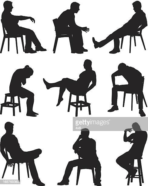 People sitting in chairs and on stools