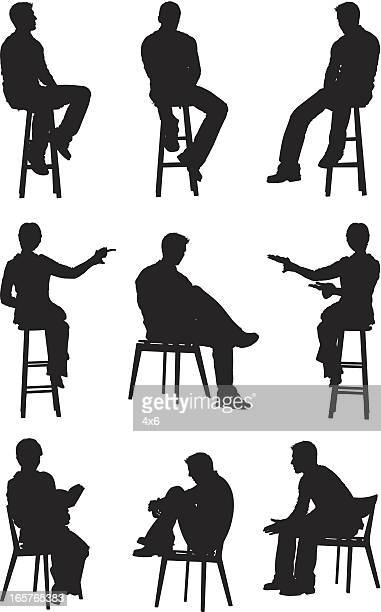 People sitting on chairs and stools