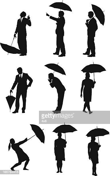 People walking with umbrellas