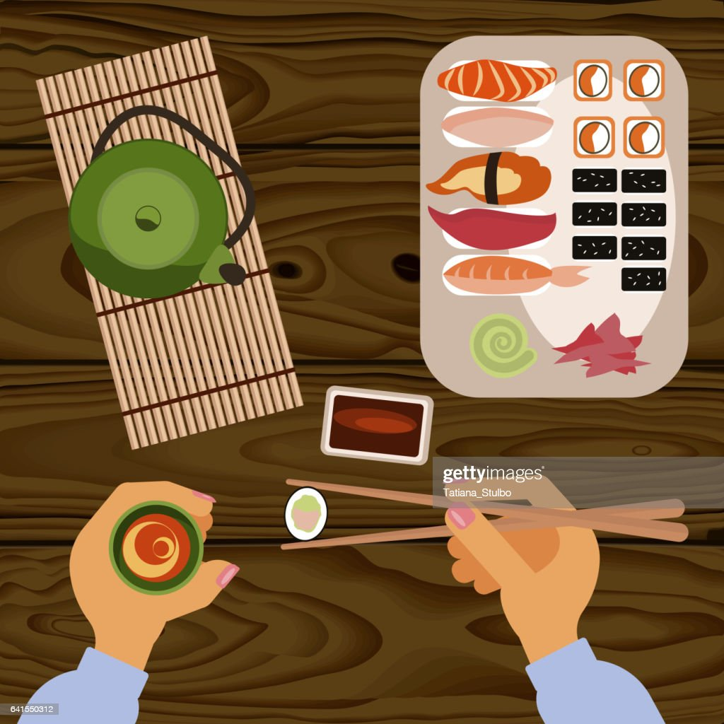 Person is eating delicious sushi
