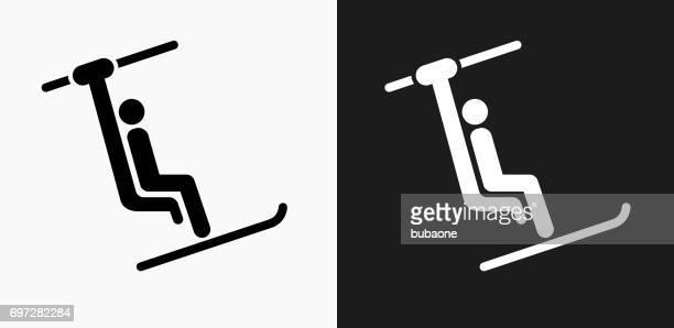 illustrazioni stock, clip art, cartoni animati e icone di tendenza di person on ski lift icon on black and white vector backgrounds - tempo turno sportivo