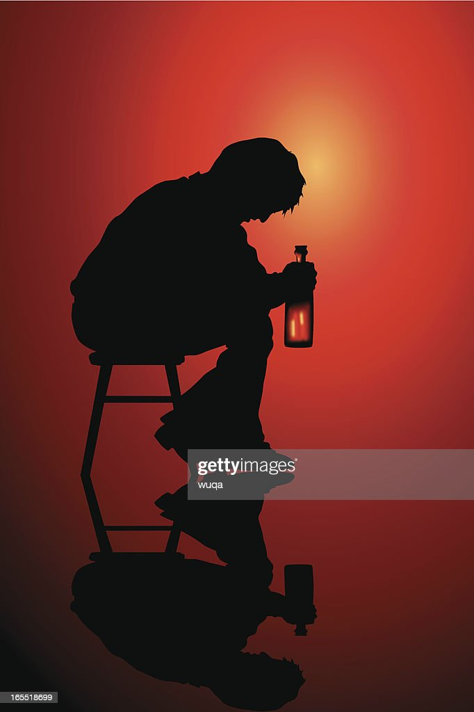 Person sitting alone on a stool drinking
