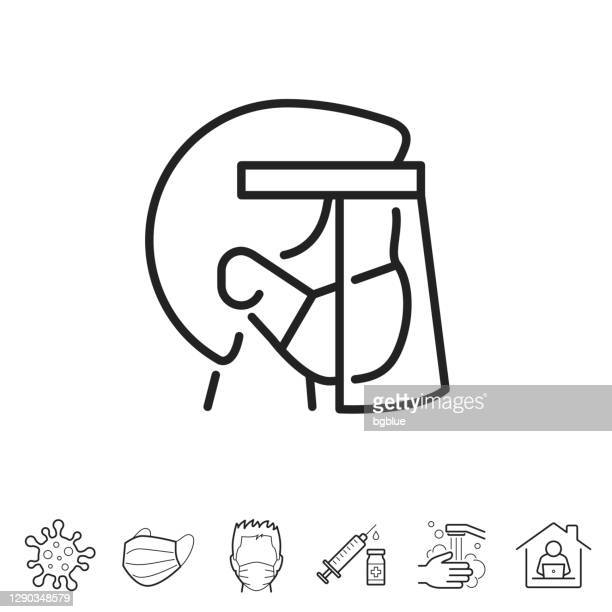 医療マスクとフェイスシールドを持つ人。線アイコン - 編集可能ストローク - フェイスシールド点のイラスト素材/クリップアート素材/マンガ素材/アイコン素材