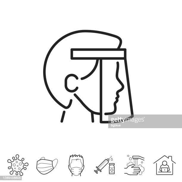 医療保護フェイスシールドを持つ人。線アイコン - 編集可能ストローク - フェイスシールド点のイラスト素材/クリップアート素材/マンガ素材/アイコン素材
