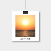 Photo frame hanging by binder clips with picture of blurred sunset over the sea. Memories of summer vector illustration. Template for photographers, websites, social media.