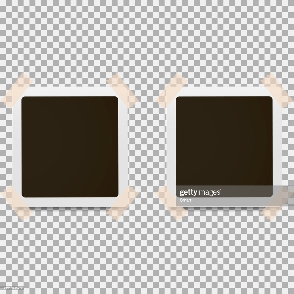 Photo frame with white contour and sticky tape on a grey background