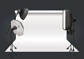 Photo studio with lighting equipment and background. Vector illustration.