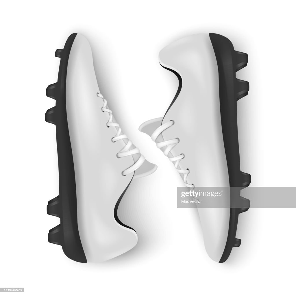 Photo-realistic vector 3d white blank pair mens football or soccer boots, shoes closeup isolated on white background. Soccer game professional footballers equipment. Design template or mockup for graphics