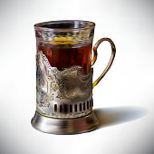 Photorealistic vector illustration cup of tea in an old cup holder