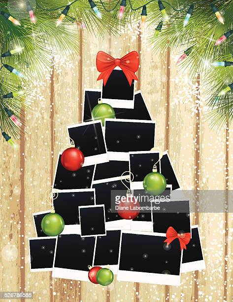 photos christmas tree and evergreens on wood background - polaroid stock illustrations, clip art, cartoons, & icons