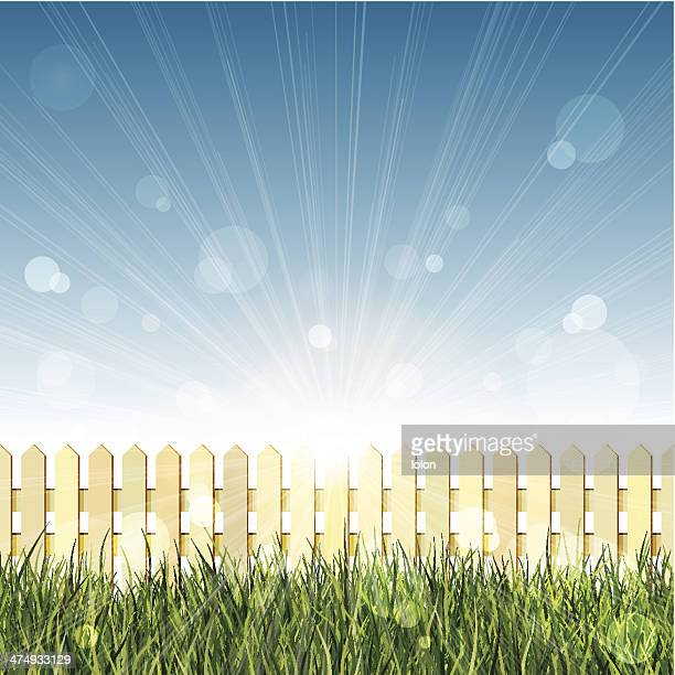 stockillustraties, clipart, cartoons en iconen met picket fence, long grass and blue sky with lens flare - lolon