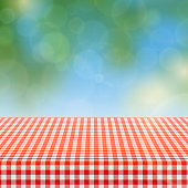 Picnic table with red checkered pattern of linen tablecloth and blurred nature background vector illustration