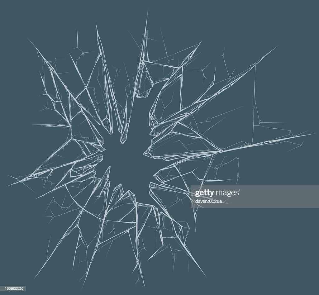 Picture of a broken glass pane on a gray background
