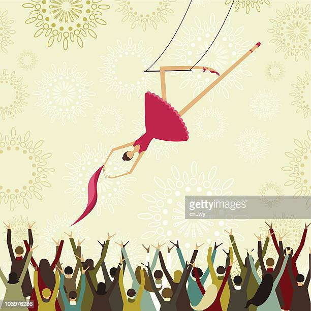 Picture of crowd cheering on a swinging trapeze artist