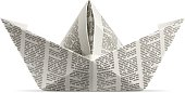 A piece of newspaper folded into an origami paper ship