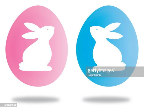 pink and blue easter bunny eggs - easter bunny stock illustrations
