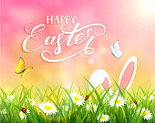 Pink background with Easter bunny in grass