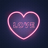 Pink bright vector heart with inscription love,  vector neon sign on brick wall. Isolated design element for Valentine's day.
