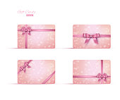 Pink gift card or gift voucher template set. Vector pink ribbons and bows on pink bokeh background.