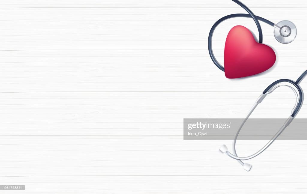 Pink heart and stethoscope on white wooden background.