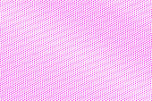 Pink on white dotted halftone. Half tone vector background. Regular dotted gradient.
