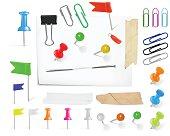 Pins and thumbtacks on paper