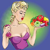 pin-up fitness girl with dumbells and vegetables