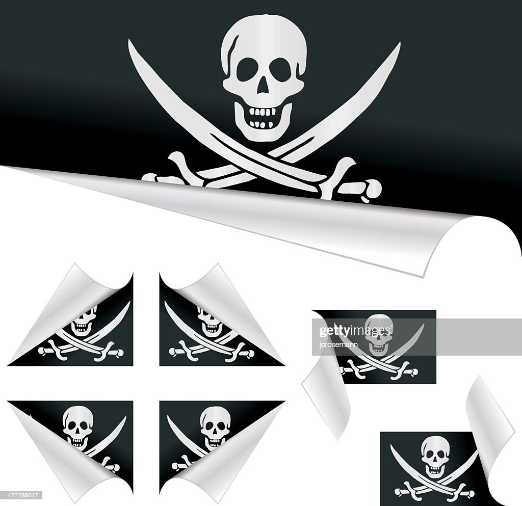 Pirates flags behind curled paper