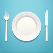 A place setting with a knife, fork, and plate