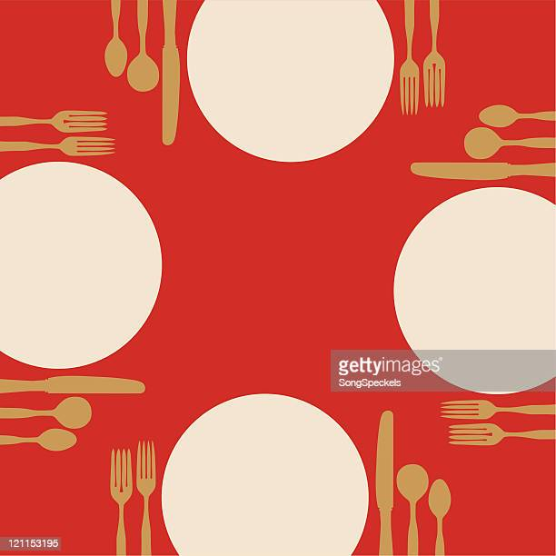 Plates and silverware on a red table