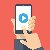Play button on smartphone screen. Watch video on mobile phone