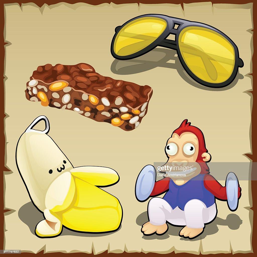 Play set of banana, toys, sweets and sunglasses
