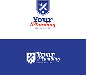 Plumbing emblem with pipe, wrench and shield