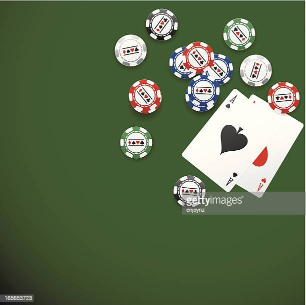 Pocket aces and chips on poker table