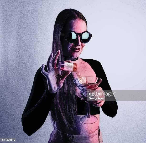 Poison Murder. Adult woman adding Roofie to a drink in a nightclub.