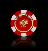 VIP poker red and white chip with golden ring and light effect vector. Black jack poker club casino four-leaf clover emblem isolated on black background