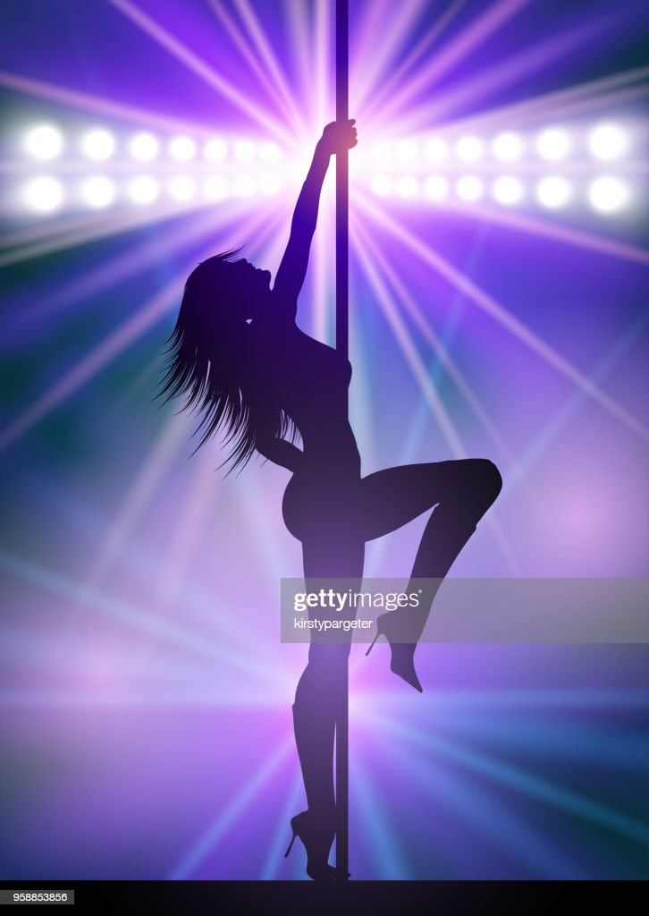 Pole dancer under spotlights