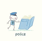 Police reads the book