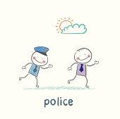Police running after a criminal
