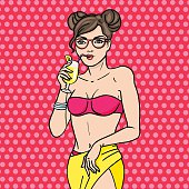 Pop art young girl in glasses drink cocktail