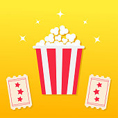 Popcorn box. Two Tickets with stars. Movie Cinema icon in flat design style. Pop corn icon. Yellow gradient background. Shining sparkles.