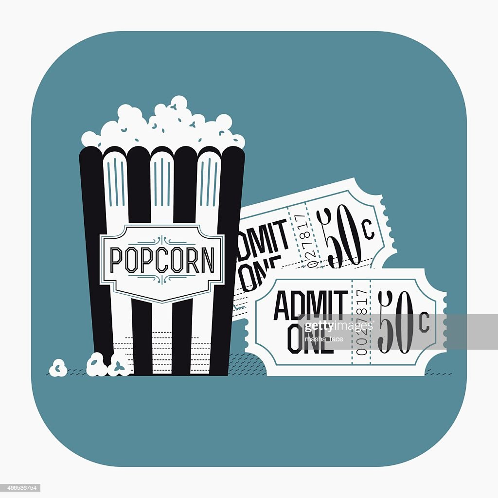 Popcorn paper bag and classic cinema theater tickets