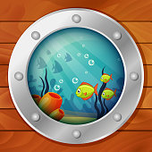 Porthole of the underwater boat. View from submarine. Underwater sea world