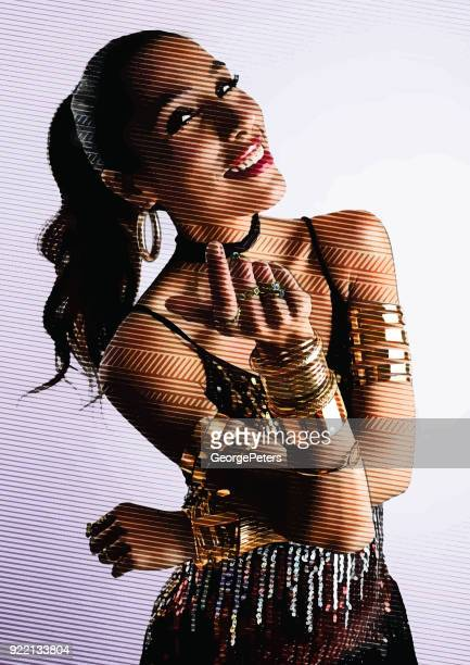 Portrait of a beautiful, smiling hispanic woman giving a beckoning hand gesture